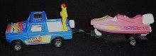 Auto s přívěsem a motorovým člunem