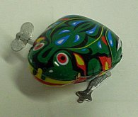 Žába plechová na klíček skakajíc...