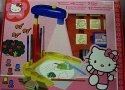 Projektor sada pro malé návrhářky Hello Kitty s razítky a fixami v krabici